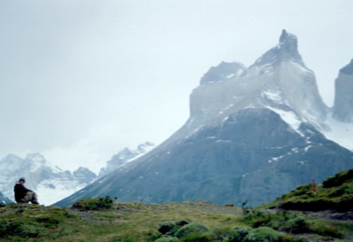 Robyn, solitary, beneath the Cuernos del Paine. This is the classic spot for Robyn.